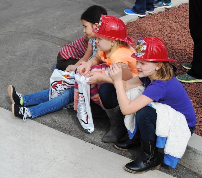 children sitting on curb