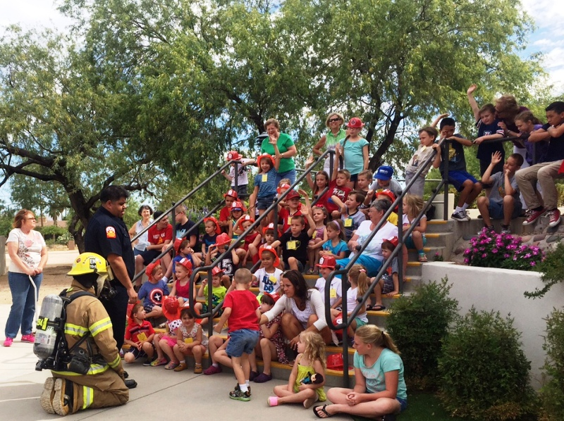 VBS kids on the steps in front of tree